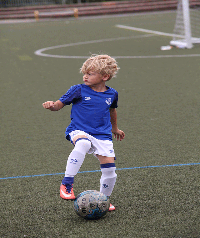 A young child participating in an FITC Academy infants and toddlers football training session.