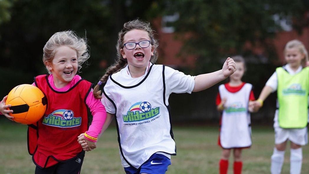 Girls enjoying a Wildcats football training session